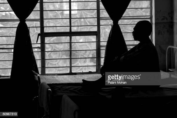 A man suffering from AIDS sits on a bed in a hospice April 14 2004 near New Delhi India A million people in the Asia and Pacific region became...