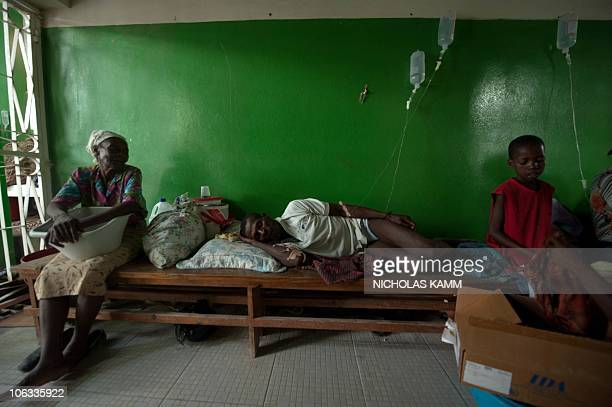 A man suffering from cholera sleeps on a bench at the Charles Colimon hospital in Petite Riviere on the Artibonite river believed to be the source of...
