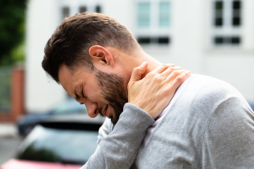 Man Suffering From Neck Pain 1013435576