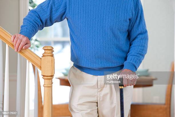man suffering from parkinson's disease and multiple sclerosis standing near steps - multiple sclerosis stock photos and pictures