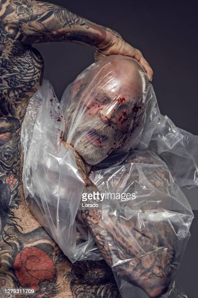 man suffering from suffocating mental illness - self harm stock pictures, royalty-free photos & images