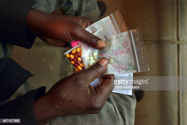 A man suffering from tuberculosis holds his medication after receiving it at a Medecins Sans Frontieres run clinic in Nairobi on March 24 World...