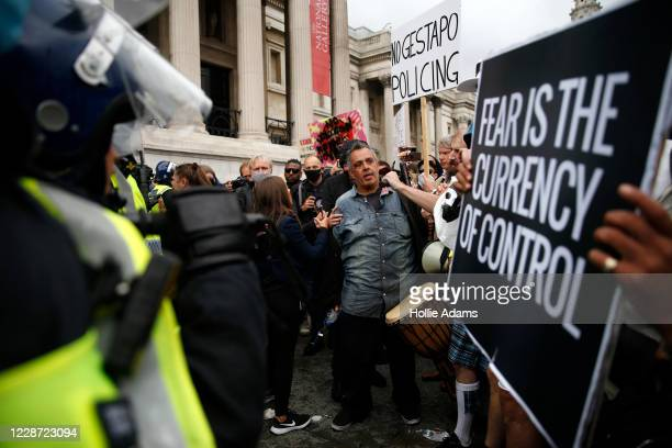 A man suffers a an injury as protesters clash with police officers during a We Do Not Consent antilockdown rally at Trafalgar Square on September 26...