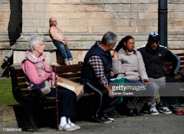 A man sunbathes in the grounds of St Botolph's Church on March 29 2019 in Boston England The town of Boston in Lincolnshire voted with a 75% majority...