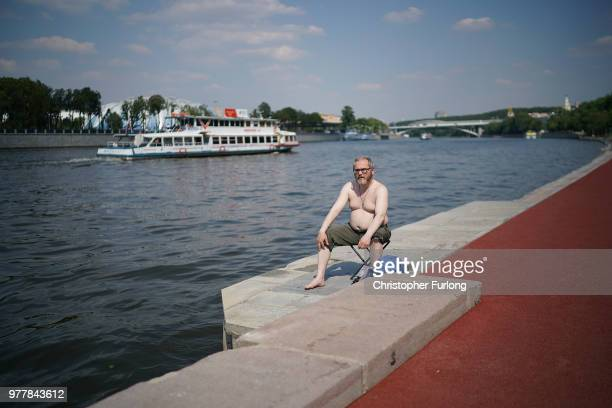 A man sunbathes on the banks of the Moscow River on June 18 2018 in Moscow Russia
