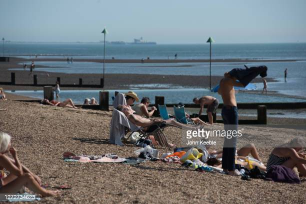 A man sunbathes on the beach on September 14 2020 in Southend on Sea England Parts of the UK are expected to hit 29 degrees celsius as the country...