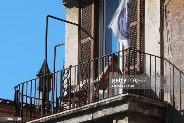 A man sunbathes on the terrace during lockdown on March 23 2020 in Rome Italy As Italy extends its nationwide lockdown to control the spread of...
