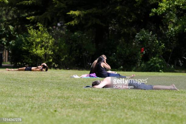 A man sunbathing at Finsbury Park on a warm and sunny day during the covid 19 crisis The UK government relaxed the guidelines on coronavirus lockdown...