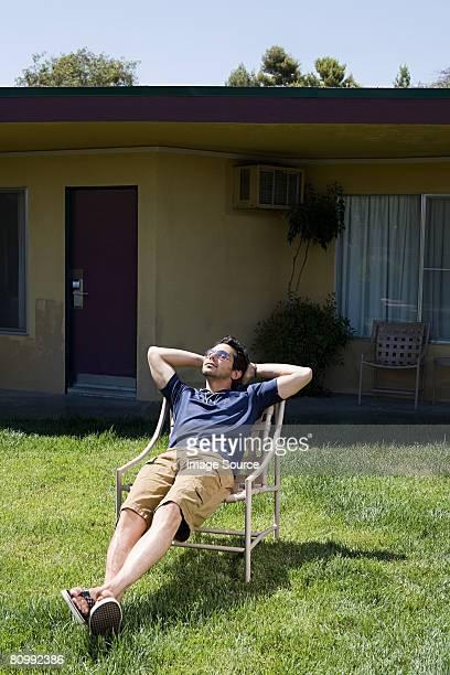 Man sunbathing at motel