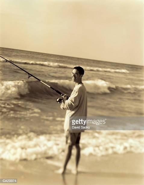 Man surf fishing, portrait (toned B&W)