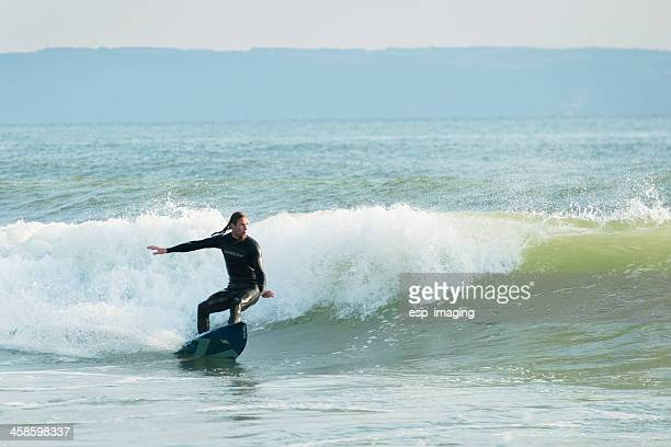man surfing in croyde bay devon - devon stock pictures, royalty-free photos & images