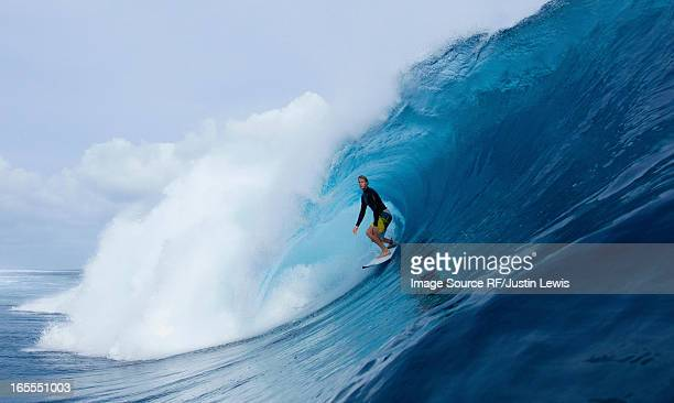 Man surfing in curl of wave