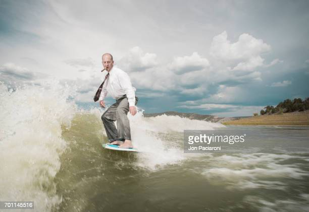 Man Surfing in Dry Business Attire