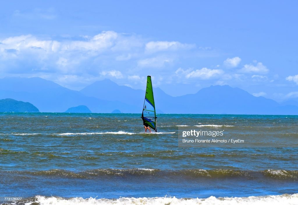 Man Surfing In Sea Against Sky : Photo