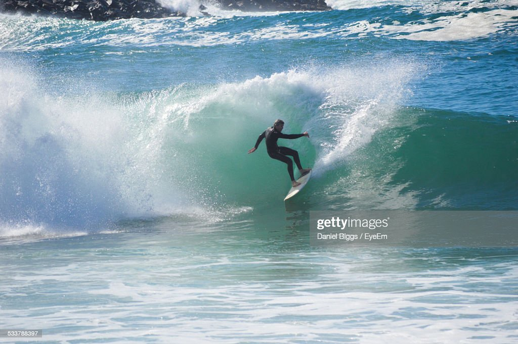 Man Surfing In Sea : Foto stock