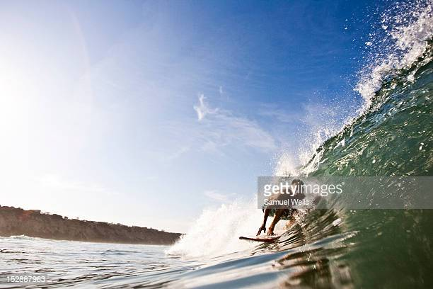 man surfing in southern california. san diego, california surfing. - carlsbad california stock pictures, royalty-free photos & images