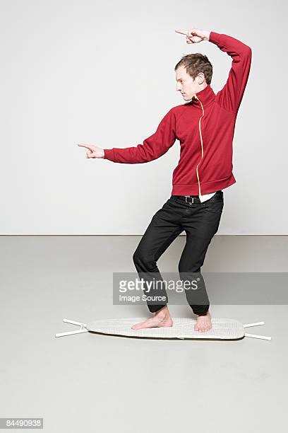 Man surfing on an ironing board