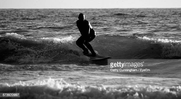 Man Surfing On Sea