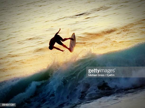 Man Surfing On Wave In Sea
