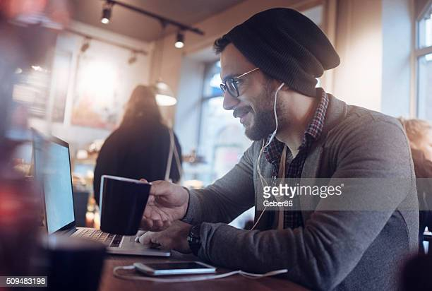 Man surfing the net in cafe