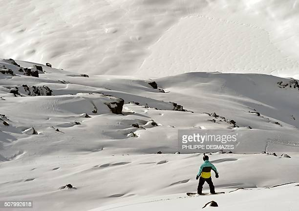 A man surfs off of marked ski slopes despite of an avalanch risk on February 2 2016 in the French ski resort of Meribel in the 3 Valleys ski area the...