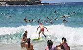 sydney australia man surfs with santa