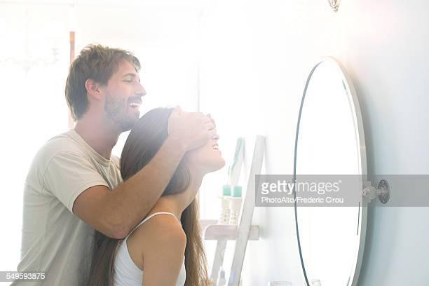 man surprising girlfriend - augen zuhalten stock-fotos und bilder
