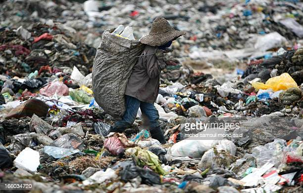 CONTENT] A man surrounded by a pile of trash scavenges for plastic for recycling at a garbage dump site in Bachok 550 kilometres 342 miles northeast...