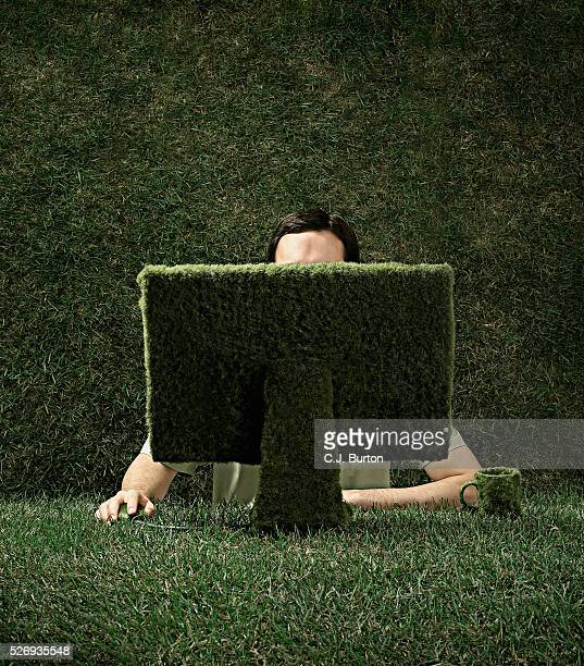 Man surrounded by grass