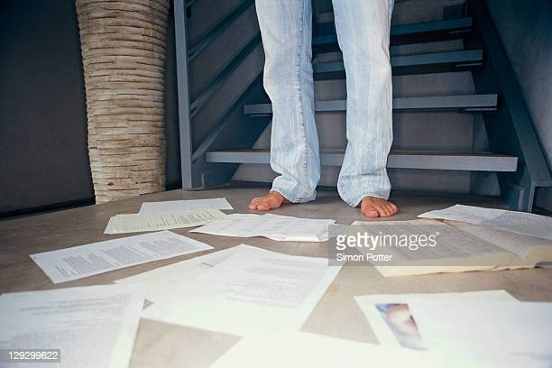 Man surrounded by papers on floor