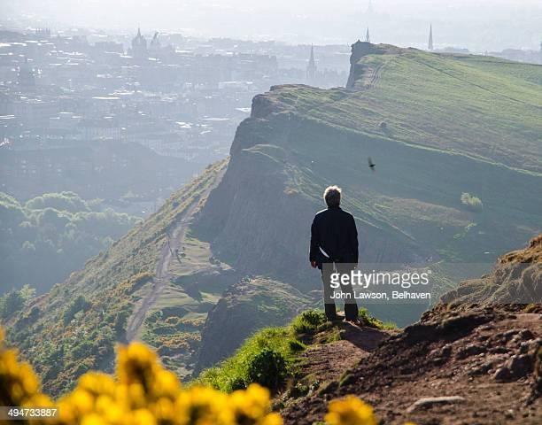 Man surveys Edinburgh from Arthur's Seat