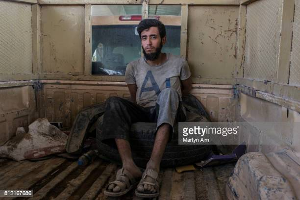A man suspected of being an Islamic State militant is detained by the Iraqi Army in the Old City district on July 10 2017 in Mosul Iraq The Iraqi...