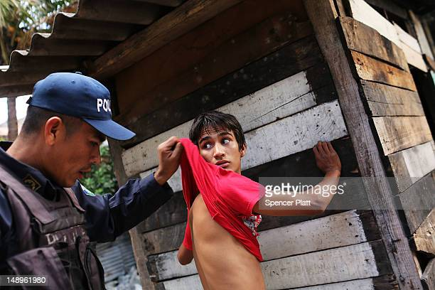 A man suspected of selling drugs is briefly searched by police on July 20 2012 in Tegucigalpa Honduras Honduras now has the highest per capita murder...