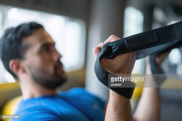 Man suspension training at the gym
