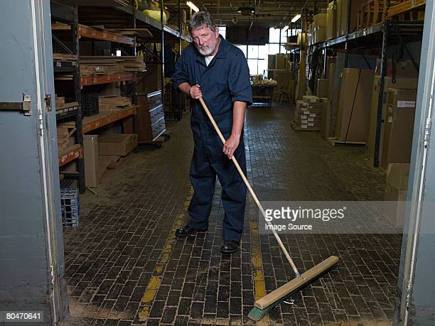 Man sweeping a warehouse