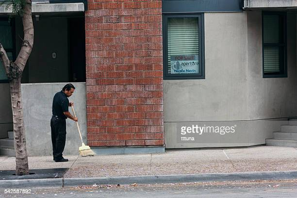 man sweeping streets