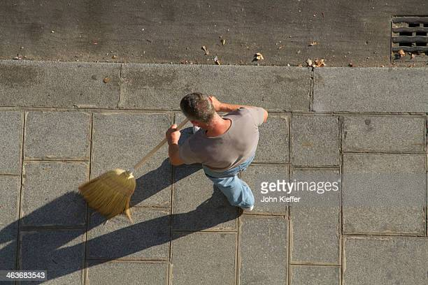 man sweeping the sidewalk - broom sweeping stock pictures, royalty-free photos & images