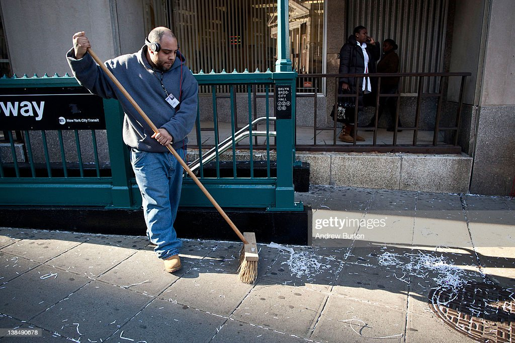 A man sweeps ticker tape after the New York Giants' Victory ceremony at City Hall on February 7, 2012 2012 in New York City. The Giants defeated the New England Patriots 21-17 in Super Bowl XLVI on Sunday, February 5, 2012.