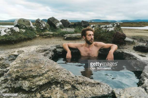 Man swimming  in hot pool in Iceland