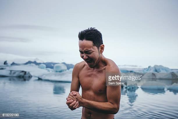 Man swimming in iceberg glacier lagoon, Jökulsárlón, Iceland