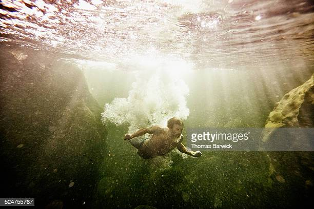 Man swimming in river underwater view