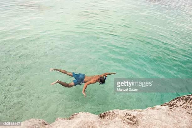 man swimming in sea, cala goloritze, sardinia, italy - cala goloritze foto e immagini stock