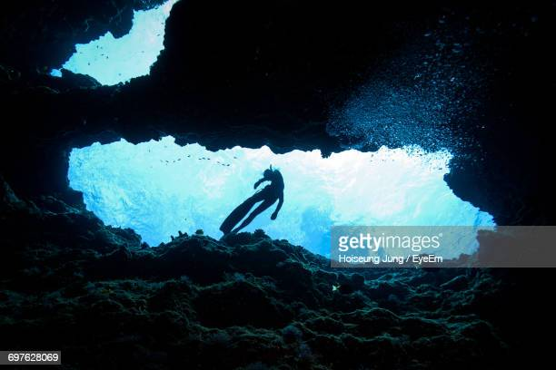 man swimming in sea - saipan stock pictures, royalty-free photos & images