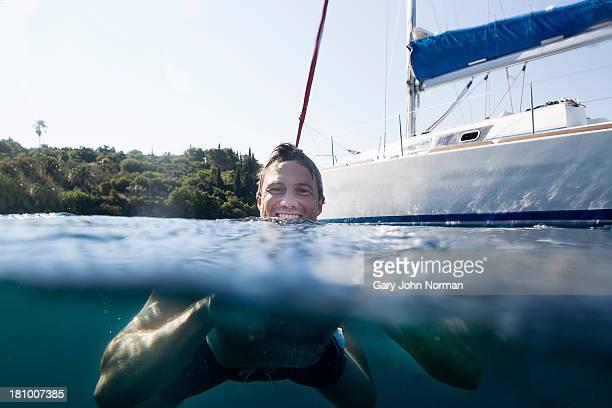 man swimming in sea,underwater