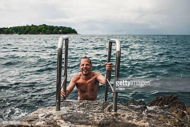 Man swimming in the Mediterranean sea croatia