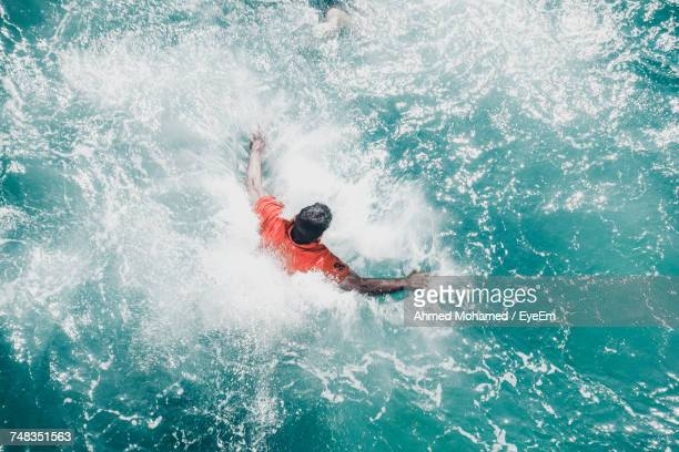 Man Swimming In Water