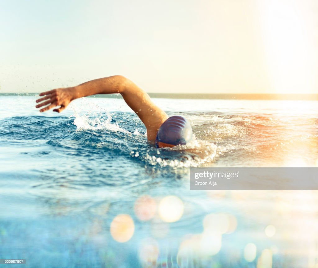 Man Swimming outdoors