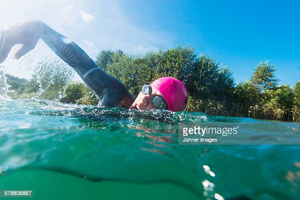 man swimming - wetsuit stock pictures, royalty-free photos & images