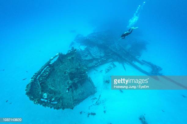 man swimming undersea - saipan stock pictures, royalty-free photos & images