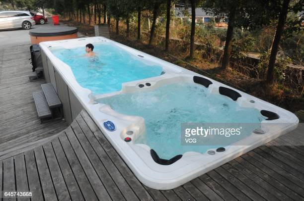 A man swims in an intelligent mini swimming pool 58 meters in length and 226 meters in width on February 26 2017 in Hangzhou China The swimming pool...
